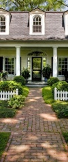 This Inviting Entry Welcomes Visitors To Walk Through A Beautifully Landscaped Garden As They Approach The Front Door